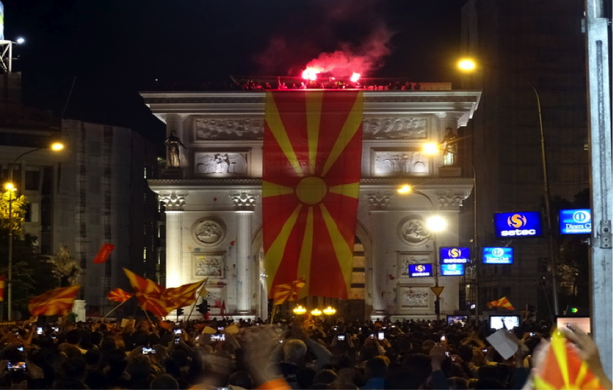 Counter-protesters putting the national flag on the Triumphal Arc as an act of showing their loyalty to the country